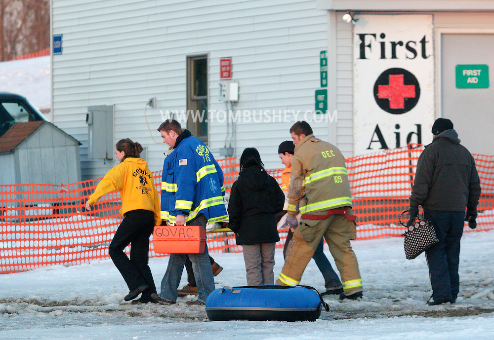 .Hamptonburgh, NY - Firefighters and first responders carry a person injured on the tubing hill at Thomas Bull Memorial Park ti a waiting ambulance on Feb. 16, 2008.