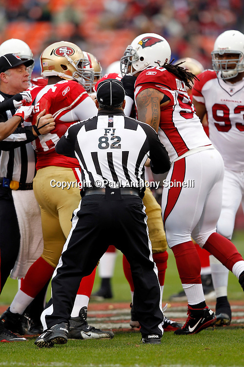 NFL field judge Buddy Horton (82) breaks up a scuffle between San Francisco 49ers offensive tackle Anthony Davis (76) and Arizona Cardinals defensive tackle Darnell Dockett (90) during the NFL week 17 football game on Sunday, January 2, 2011 in San Francisco, California. The 49ers won the game 38-7. (©Paul Anthony Spinelli)