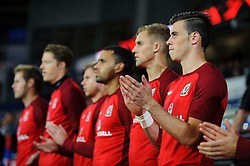 Gareth Bale of Wales (Real Madrid) looks on from the bench during the anthems before the match - Photo mandatory by-line: Rogan Thomson/JMP - Tel: Mobile: 07966 386802 10/09/2013 - SPORT - FOOTBALL - Cardiff City Stadium - Cardiff -  Wales V Serbia- World Cup Qualifier.