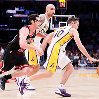 09 February 2014: Los Angeles Lakers point guard Steve Nash (10) drives past Chicago Bulls shooting guard Kirk Hinrich (12) on a screen set by Los Angeles Lakers center Robert Sacre (50) during the Chicago Bulls 92-86 victory over the Los Angeles Lakers at the Staples Center, Los Angeles, California, USA.
