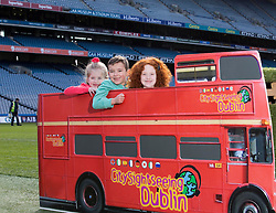 Repro Free: 03/03/2014 Ella Crolly (7) from Malahide, Kyle Burkem, (6) from Donaghmede and Alisha Burke (6) Artane find themselves in the middle of Croke Park as they help launch of the new City Sightseeing bus route at Croke Park stadium which now encompasses the Botanic Gardens, Glasnevin Cemetery and Croke Park.<br /> The new route will be open to the public from March 10th 2014 and extends the existing tour route. This &lsquo;true blue&rsquo; route will take visitors on a journey that gives an insight into the struggles and victories that shaped this country encapsulating social, cultural and sporting history, amazing views and landscapes from three of Dublin&rsquo;s top 10 attractions (Tripadvisor). In this decade of commemorations, these sites are at the forefront in remembering and commemorating great events and people in Irish history. Picture Andres Poveda