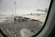commercial passenger airplane being de iced Munich Germany