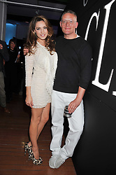 KELLY BROOK and GILES DEACON at a party for Giles Deacon hosted by Mercedes Benz held at Elms Lesters Painting Rooms, Flitcroft Street, London WC2 on 19th September 2011.