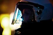 Dresden | 19.11.2011..Neonazis aus ganz Deutschland und aus anderen Ländern Europas planten in Dresden wie in den vergangenen Jahren eine Demonstration (Trauermarsch), um an die Bombardierung Dresdens am 13.02.1945 zu erinnern. Der Tag entwickelte sich für die Neonazis zum Fiasko, über 20000 Demonstranten verhinderten mit Mahnwachen, Demonstrationen und Blockaden die Demo-Versuche der Neonazis..Hier: Polizeibeamte sichern den Dresdner Ortsteil Plauen, in dem sich Neonazis versammelt haben. Hier eine junge Polizistin mit Helm im Gegenlicht...©peter-juelich.com..[No Model Release | No Property Release]