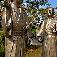 Yoshii Tomozane and Ijichi Shôji Statues in Kagoshima, Japan <br /> In Chuo Park (Central Park) is another pair of sculptures in the Tokishirube series protraying key figures from the late 19th century. Yoshii Tomozane was instrumental in overthrowing Tokugawa Yoshinobu, the last of the Tokugawa shogunate in 1867. This led to the return of imperial rule the following year. Ten years later, Ijichi Shôji – who was the head of military instruction for the Satsuma hu, a regional domain ruled by a daimyo (military lord) – was the strategist for the failed Satsuma Rebellion. This defeat solidified the emperor's dominance, ended Japan's isolation and set the course for modernization during the Meiji period.