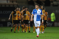 Billy Bodin of Bristol Rovers cuts a dejected figure as Barry Corr of Cambridge United celebrates with his team mates after scoring - Mandatory byline: Dougie Allward/JMP - 07966 386802 - 30/10/2015 - FOOTBALL - The Abbey Stadium - Cambridge, England - Cambridge United v Bristol Rovers - Sky Bet League Two