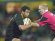 Photo - Peter Spurrier.13/01/2003.Parker Pen Shield European Rugby - Saracens v Newcastle.Epi Taione tries to go around Tom Shanklin.