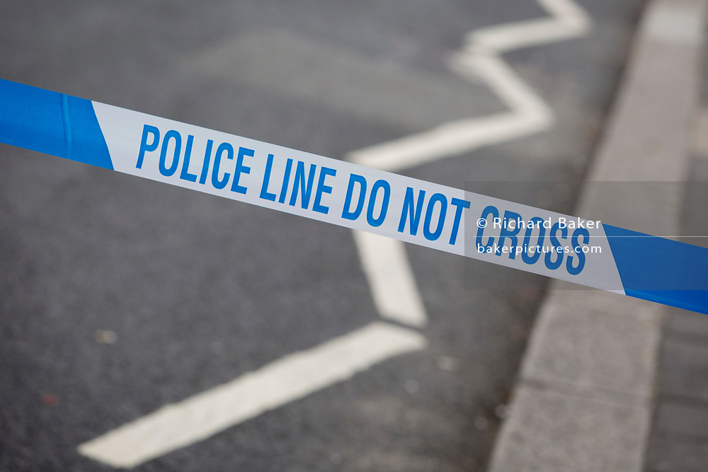 Police tape blocks a road as Westminster experiences a lockdown with extensive cordons and the closure of many streets after what police are calling a terrorist incident in which a car was crashed into security barriers outside parliament in central London, on 14th August 2018, in London, England.