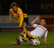 Ryan Bird of Cambridge United is tackled by Jake Howells of Luton Town during the Skrill Conference Premier match at the Abbey Stadium, Cambridge<br /> Picture by David Horn/Focus Images Ltd +44 7545 970036<br /> 11/03/2014