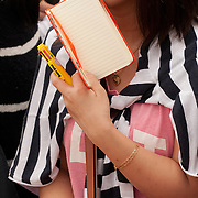 A girl holds a notebook for autographs as she waits for the stars of 'Nameless Gangster: Rules of the Time' to arive at Haeundae BIFF Village.