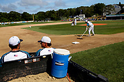 Members of the Brewster Whitecaps prepare the field before game one of the Cape Cod League Championship Series against the Bourne Braves at Stony Brook Field on August 11, 2017 in Brewster, Massachusetts.