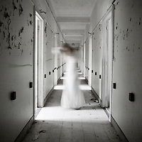 ghostly woman in a abandoned hallway