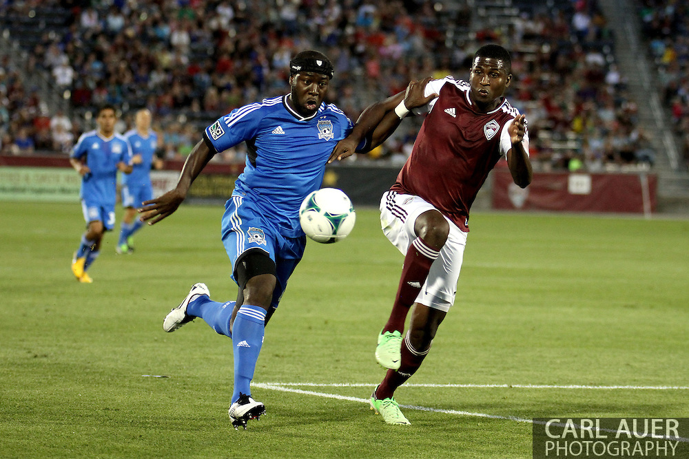 June 15th, 2013 - Colorado Rapids forward Edson Buddle (9) and San Jose Earthquake defender Nana Attakora (23) chase after the ball in the second half of the MLS match between San Jose Earthquake and the Colorado Rapids at Dick's Sporting Goods Park in Commerce City, CO