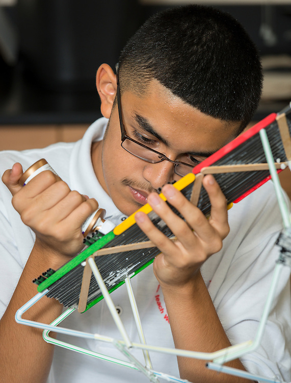Students work on bridges at Furr High School, September 18, 2014.