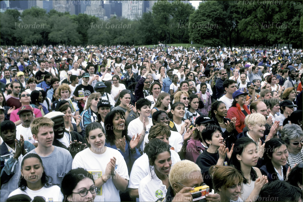 Large crowd - audience in Central Park listening to speakers at rally, NYC
