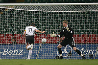 Photo: Rich Eaton.<br /> <br /> Wales v Germany. UEFA European Championships Qualifying. 08/09/2007. Germany's Miroslav Klose #11 scorers past Wales keepwe Wayne Hennessey.