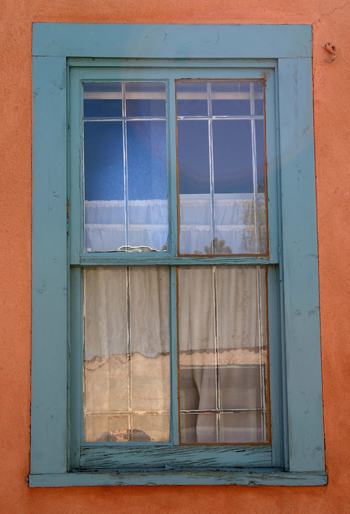 Turquoise window on adobe wall Santa Fe New Mexico