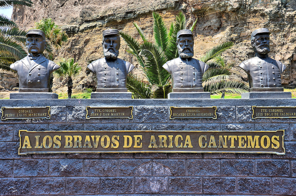 Battle of Arica War Heroes Monument in Arica, Chile <br /> This monument called A Los Bravos de Arica Cantemos is a tribute to four Chilean heroes during the War of the Pacific and specifically the Battle of Morro de Arica in June of 1880.  On the left is Pedro Largo Merchant, a brigadier general whose forces captured Arica from the Peruvian army.  Next is Lieutenant Colonel Juan J. San Martin who was killed while leading his 4th Line Regiment towards the enemy. Lieutenant Ricardo Silva Arriagada raised the Chilean flag atop El Morrow as the battle concluded. Finally on the right is Luis Solo de Zaldivar.  He was a Sargent Major of the 4th Line during the Battle of Arica.
