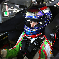 Driver Danica Patrick sits in her race car during the first practice session of the 56th Annual NASCAR Coke Zero400 race at Daytona International Speedway on Thursday, July 3, 2014 in Daytona Beach, Florida.  (AP Photo/Alex Menendez)