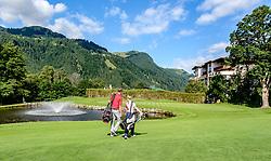 THEMENBILD - Zwei Golfspieler am Golfclub Eichenheim mit dem Hahnenkamm im Hintergrund, aufgenommen am 04. Juli 2017, Kitzbühel, Österreich // Two golfers at the Eichenheim Golfclub with the Hahnenkamm in the background at Kitzbühel, Austria on 2017/07/04. EXPA Pictures © 2017, PhotoCredit: EXPA/ Stefan Adelsberger