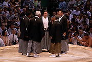 Judges conferring their decision after a bout in the controversial Nagoya summer Grand Sumo Tournament held on the 14th and second final day.