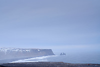 Reynisfjara beach and Reynisdrangar Sea Stacks, view from top of Dyrhólaey Peninsula. South Iceland.