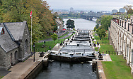 Locks 1-8 on the Rideau Canal in Ottawa, Ontario. These locks allow boats to pass through the 24.1m ( 79 ft.) elevation change between the Rideau Canal and the Ottawa River.  The Bytown Museum, Ottawa River, and the Alexandra Bridge are in the background.