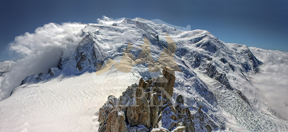 A panoramic view of Mont Blanc Massif and the surrounding summits, as seen from Cosmiques ridge, close to Aiguille du Midi cable car station, Chamonix, France.