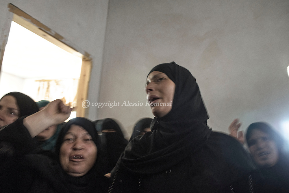 Gaza Strip, Khan: Palestinian women mourn during the funeral of the Abu Muamar family in Khan Younis, southern Gaza Strip on July 14, 2014. The family of three was killed in an airstrike . ALESSIO ROMENZI