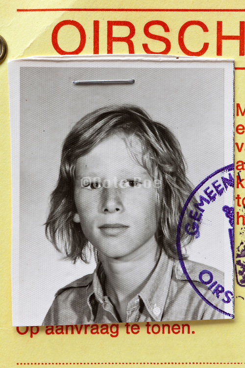 detail of identity document with photo of a young boy 1970s