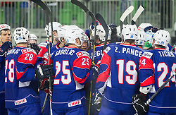 Players of Slovenia celebrate after winning the ice-hockey match between Great Britain and Slovenia at IIHF World Championship DIV. I Group A Slovenia 2012, on April 15, 2012 in Arena Stozice, Ljubljana, Slovenia. Slovenia defeated Great Britain 3-2. (Photo by Vid Ponikvar / Sportida.com)