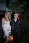 "Meredith Ostron and Nick Rhodes. aftershow party followlng the UK Premiere of ""Stoned,"" at Century on November 17, 2005 in London, England. 17 November 2005. ONE TIME USE ONLY - DO NOT ARCHIVE  © Copyright Photograph by Dafydd Jones 66 Stockwell Park Rd. London SW9 0DA Tel 020 7733 0108 www.dafjones.com"