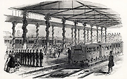 Queen Victoria changing trains at Gloucester, 1849. Sambaed Kingdom Brunel (1806-1859) favoured the 7ft 1/4inch (2.2m) broad gauge and designed the Great Western Railway accordingly. However, in the Gauge Act of 1846 Parliament declared that all future railway track should be of the standard 4ft 8 1/2inch (1.44m) gauge introduced by George Stephenson (1781-1848) on the Liverpool & Manchester Railway.  It was not until 1892 that the last broad gauge track was lifted.  On her journey back to London from Balmoral the Queen changed from the standard gauge Midland Railway to the broad gauge Great Western Railway. From 'The Illustrated London News'. (London, 6 October 1849).