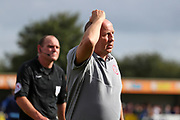 Accrington Stanley manager John Coleman scratching head during the EFL Sky Bet League 1 match between AFC Wimbledon and Accrington Stanley at the Cherry Red Records Stadium, Kingston, England on 17 August 2019.