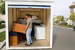 Homeowner packs up belongings for storage.The Vallejo, Calif., couple lost their home in 2009 to foreclosure due to a combination of job loss, adjustable loan payments doubling and  home value under water nearly fifty percent. Photo by Kim Kulish