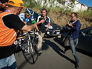 Post finish, Contador fights off yet another chase group--but this time it's a running pack of journalists.  He thinned down the group by making them sprint for 130 meters before slowing down. Now let's see if he takes interviews.