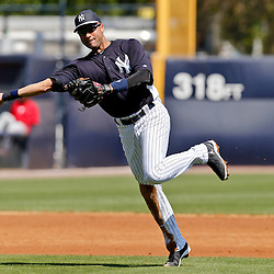 Mar 16, 2013; Tampa, FL, USA; New York Yankees shortstop Derek Jeter (2) throws to first for an out against the Philadelphia Phillies during the top of the third inning of a spring training game at George Steinbrenner Field. Mandatory Credit: Derick E. Hingle-USA TODAY Sports