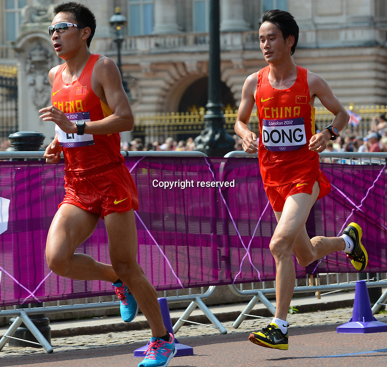 12.08.2012. London, England.  Li and Dong of China compete in the Mens Marathon Competition London 2012 Olympic Games