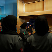 November 14, 2012 - Kabul, Afghanistan: Afghan National Police (ANP) female cadets inspection the arms deposit at the Afghan Nacional Police Academy...ANP Academy trains 1250 cadets at the time during a period of four years. Every year, five hundred new recruits are selected, out of more than nine thousand of candidates, to join the academy and other five hundred graduate. Fifteen per cent of the recruits are women. (Paulo Nunes dos Santos)