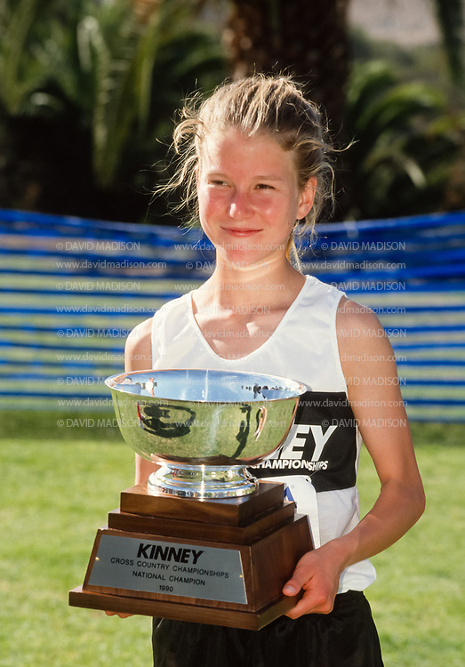 SAN DIEGO - DECEMBER 8:  Melody Fairchild #31 of the United States holds the trophy for winning the 1990 Kinney Cross Country Championships on December 8, 1990 at Balboa Park in San Diego, California.  The meet later became known as the Foot Locker Cross Country Championships.  (Photo by David Madison/Getty Images)