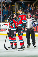 KELOWNA, CANADA - NOVEMBER 21: Erik Gardiner #11 stands on the ice with Braydyn Chizen #22 of the Kelowna Rockets during a time out against the Regina Pats  on November 21, 2018 at Prospera Place in Kelowna, British Columbia, Canada.  (Photo by Marissa Baecker/Shoot the Breeze)