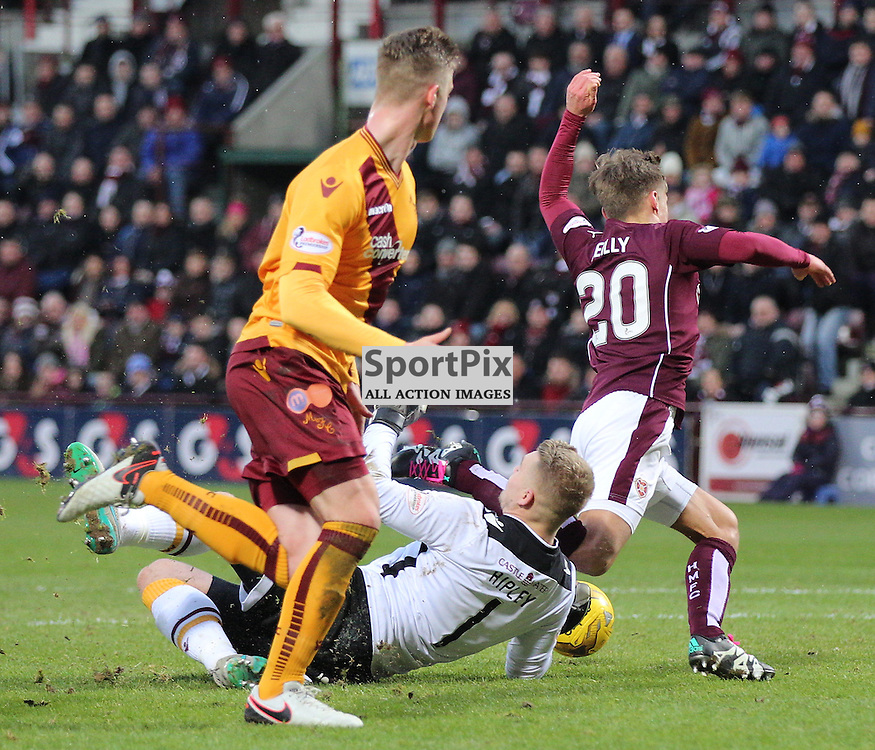Hearts v Motherwell Scottish Premiership 16 January 2016; Gavin Reilly (Hearts, 20) is brought down by Connor Ripley (Motherwell, 1) for a penalty during the Heart of Midlothian v Motherwell Scottish Premiership match played at Tynecastle Stadium, Edinburgh; <br /> <br /> &copy; Chris McCluskie | SportPix.org.uk
