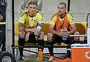 Phoenix's Ben Sigmund (L) with team mate Manny Muscat sit on the team bench after their last game for the Phoenix during the A-League - Wellington Phoenix v Western Sydney football match at Westpac Stadium in Wellington on Sunday the 10 April 2016. Copyright Photo by Marty Melville / www.Photosport.nz