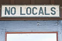 No Locals signage