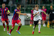 (R) Legia's Jakub Kosecki fights for the ball during the UEFA Champions League play-off second leg match between Legia Warsaw and FC Steaua Bucuresti at Pepsi Arena Stadium in Warsaw on August 27, 2013.<br /> <br /> Poland, Warsaw, August 27, 2013<br /> <br /> Picture also available in RAW (NEF) or TIFF format on special request.<br /> <br /> For editorial use only. Any commercial or promotional use requires permission.<br /> <br /> Photo by © Adam Nurkiewicz / Mediasport