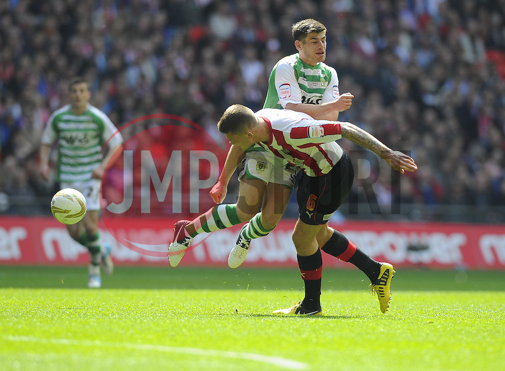 Yeovil Town's Joe Edwards clashes with Brentford's Harlee Dean - Photo mandatory by-line: Joe Meredith/JMP - Tel: Mobile: 07966 386802 19/05/2013 - SPORT - FOOTBALL - LEAGUE 1 - PLAY OFF - FINAL - Wembley Stadium - London - Brentford V Yeovil Town
