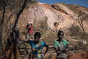 Women waiting to receive mine waste material to separete cobalt from mud and rocks in a mine between Lubumbashi and Kolwezi, May 31, 2015. AFP PHOTO/FEDERICO SCOPPA