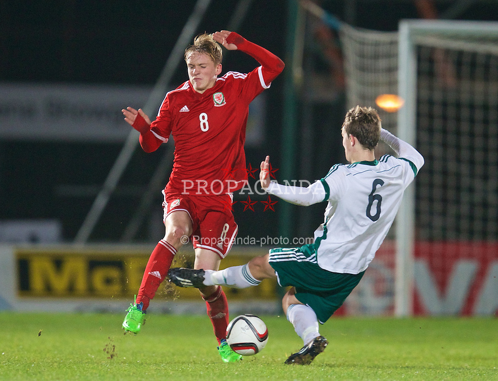 BALLYMENA, NORTHERN IRELAND - Thursday, November 20, 2014: Wales' Matty Smith in action against Northern Ireland's Liam McKenna during the Under-16's Victory Shield International match at the Ballymena Showgrounds. (Pic by David Rawcliffe/Propaganda)
