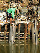 14 JULY 2015 - THAILAND: Workers keep pumps working at the water processing plant in Pathum Thani province. The drought that has crippled agriculture in central Thailand is now impacting residential areas near Bangkok. The Thai government is reporting that more than 250,000 homes in the provinces surrounding Bangkok have had their domestic water cut because the canals that supply water to local treatment plants were too low to feed the plants. Local government agencies and the Thai army are trucking water to impacted communities and homes. Roads in the area have started collapsing because of subsidence caused by the retreating waters. Central Thailand is contending with drought. By one estimate, about 80 percent of Thailand's agricultural land is in drought like conditions and farmers have been told to stop planting new acreage of rice, the area's principal cash crop.       PHOTO BY JACK KURTZ