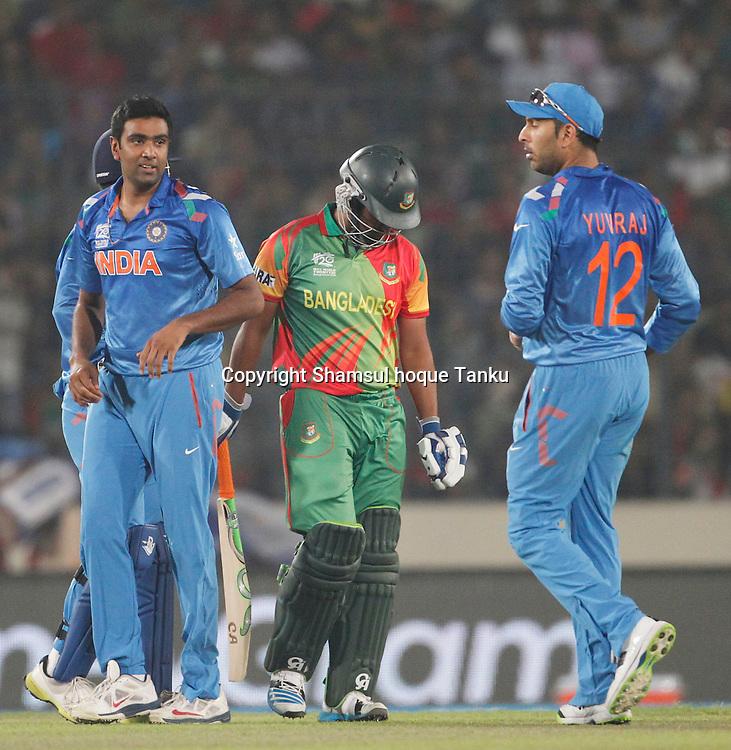 India celebrate Tamim Iqbal's wicket - Bangladesh v India - ICC World Twenty20, Bangladesh 2014. 29 March 2014, Sher-e-Bangla National Cricket Stadium, Mirpur. Photo: Shamsul hoque Tanku/www.photosport.co.nz